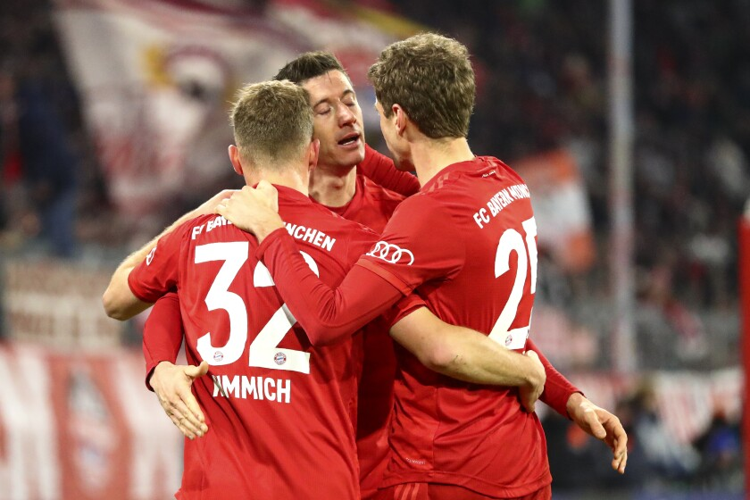 Bayern's Robert Lewandowski celebrates after scoring his side's fourth goal during the German soccer cup match between Bayern Munich and TSG Hoffenheim in Munich, Germany, on Wednesday.