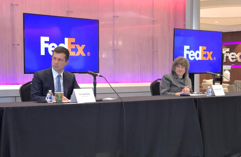 U.S. Department of Transportation Secretary Pete Buttigieg, left, and Acting Administrator for the Federal Highway Administration Stephanie Pollack listen to a speaker during a discussion at a FedEx Corp. facility about the closure of the Interstate 40 bridge on Thursday, June 3, 2021, in Memphis, Tenn. (AP Photo/Adrian Sainz)