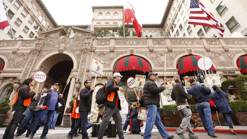 Hotel workers from Unite Here Local 11 demonstrate in front of the Beverly Wilshire, which does not yet have an agreement with the union to stave off a strike.