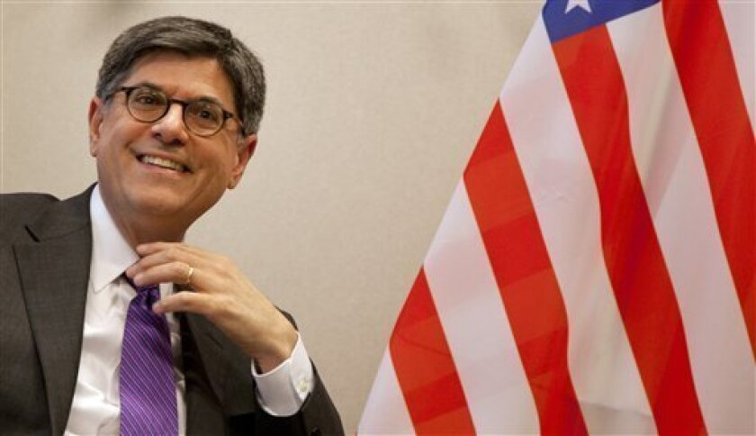 U.S. Treasury Secretary Jacob Lew smiles at journalists prior to a meeting with European Council President Herman Van Rompuy, not shown, at EU headquarters in Brussels on Monday, April 8, 2013. U.S. Treasury Secretary Jacob Lew is starting a series of meetings with key European Union leaders during