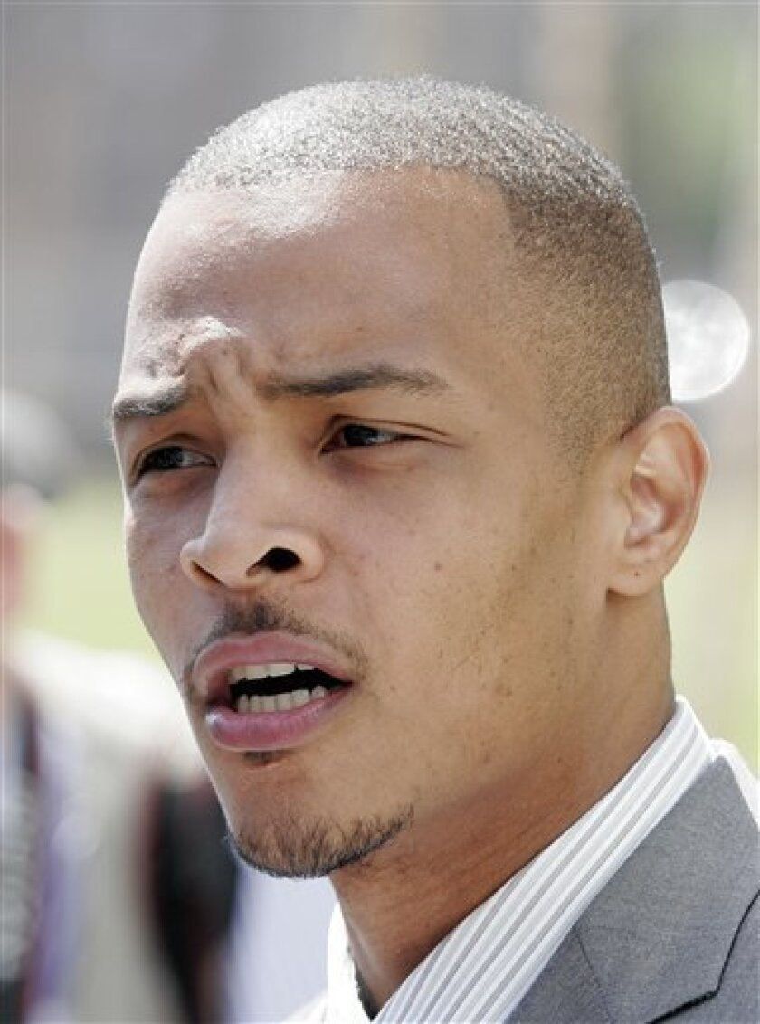 FILE - Rapper T.I. whose real name is Clifford Harris speaks to reporters outside the Richard B. Russell Federal Courthouse in Atlanta, in this March 27, 2008 file photo. (AP Photo/John Bazemore, File)