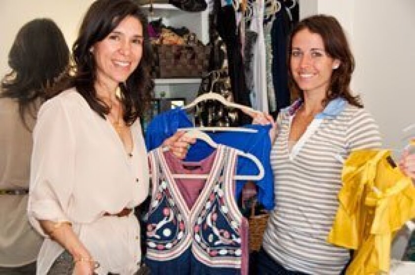 Catherine Bachelier Smith (left) does a closet consultation for client Tracy Schwartz, a Solana Beach resident.