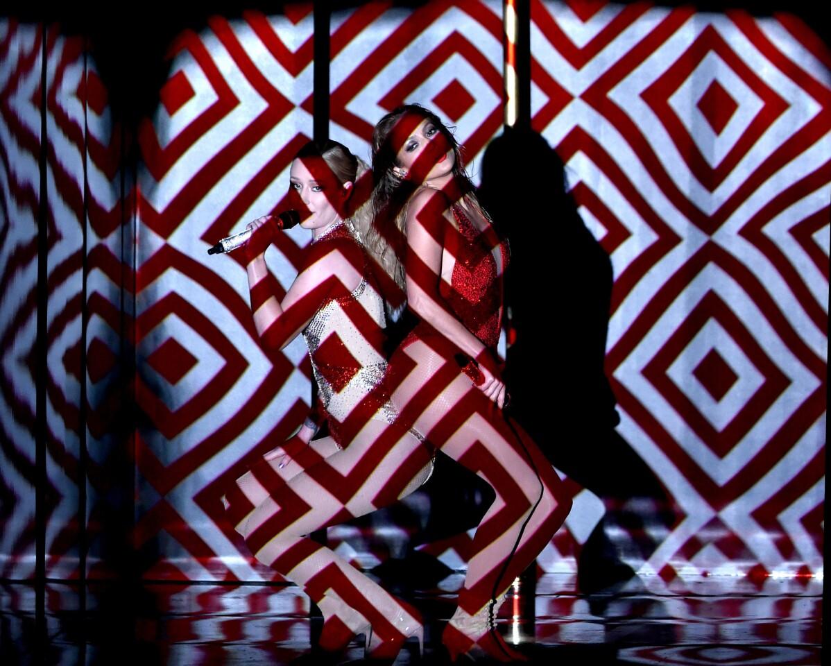 Iggy Azalea, left, and Jennifer Lopez perform.
