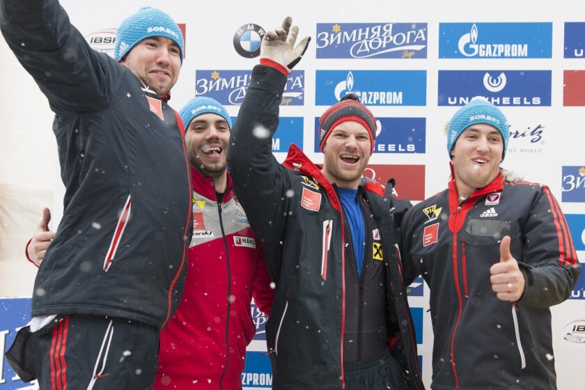 Austria's Benjamin Maier, Marco Rangl, Markus Sammer and Danut Ion Moldovan, from left to right,  celebrate their second place after the men's 4-man bobsled  World Cup competition in St. Moritz, Switzerland, Sunday,  Feb. 7, 2016.  (Urs Flueeler/Keystone via AP)