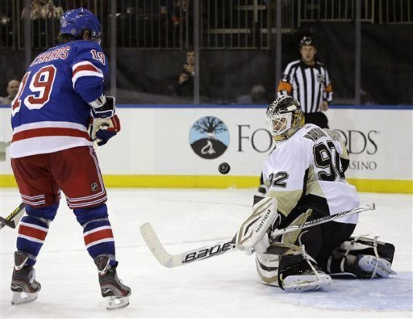 New York Rangers center Brad Richards (19) watches as Pittsburgh Penguins goalie Tomas Vokoun (92), of the Czech Republic, makes a save in the second period of their NHL hockey game in New York, Thursday, Jan. 31, 2013. (AP Photo/Kathy Willens