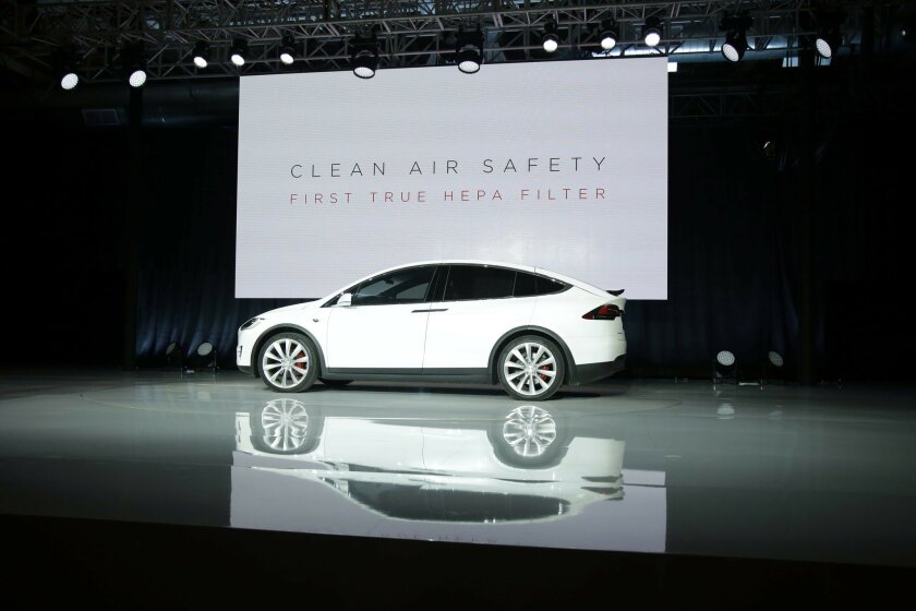 FILE - In this Sept. 29, 2015, file photo, the Tesla Model X car is unveiled at the company's headquarters in Fremont, Calif. (AP Photo/Marcio Jose Sanchez, File)