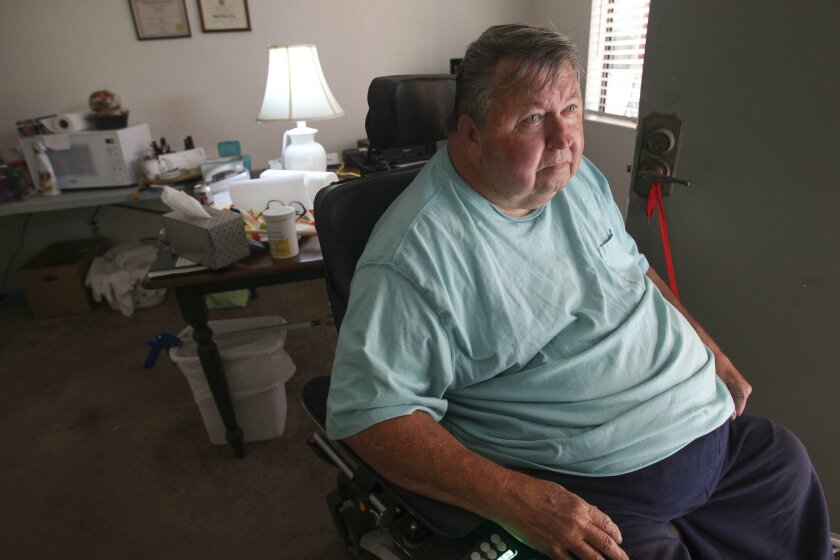 Bill Freeborn in his apartment at The Parkview apartments in Hillcrest on Wednesday. Freeborn is one of several senior residents that have to look for a new place to live due to the rent being raised at the apartment complex.