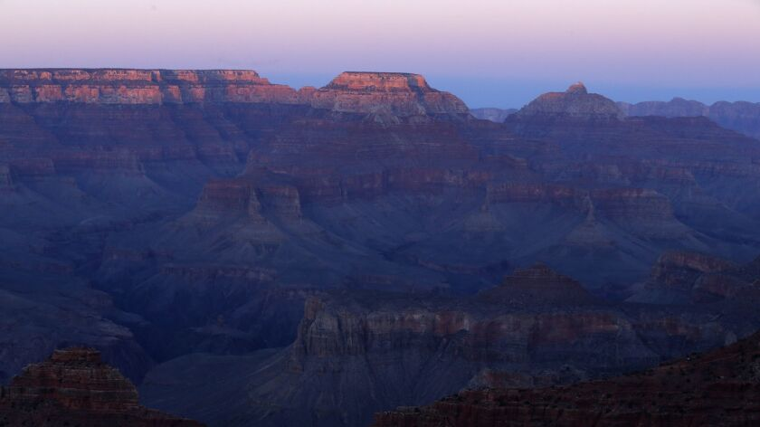 GRAND CANYON, AZ., MARCH 9, 2015: The sun sets on the Grand Canyon March 9, 2015. Formed by the mean