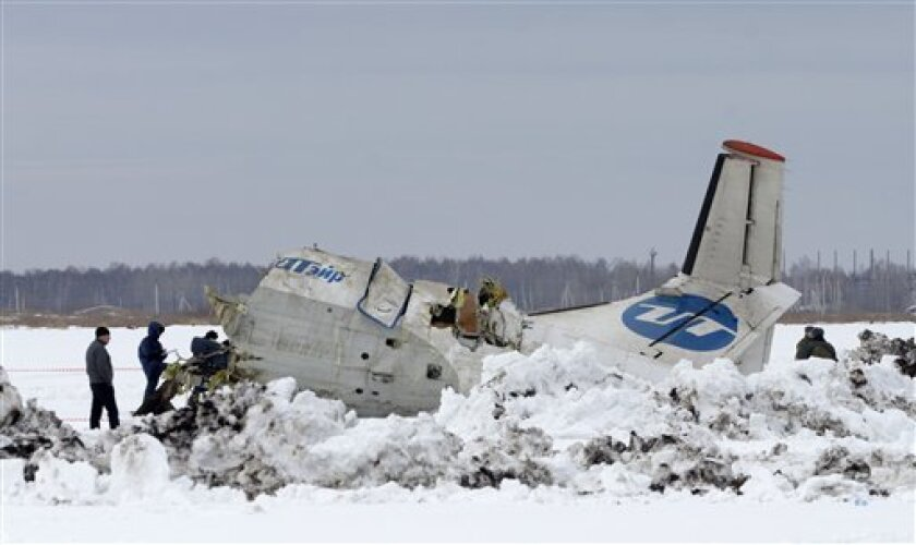 Russian Emergency Ministry rescuers search the site of the ATR-72 plane crash outside Tyumen, a major regional center in Siberia, Russia, Monday, April 2, 2012. A passenger plane crashed in Siberia shortly after taking off on Monday morning, killing 32 of the 43 people on board, Russian emergency officials said. The 11 survivors were hospitalized in serious condition. The ATR-72, a French-Italian-made twin-engine turboprop, operated by UTair was flying from Tyumen to the oil town of Surgut with 39 passengers and four crew. (AP Photo/Marat Gubaydullin)
