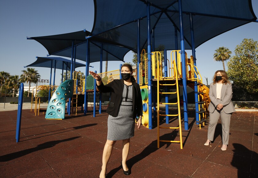 Cerritos Elementary School Principal Perla Chavez-Fritz, left, shows her Glendale campus to L.A. County schools chief