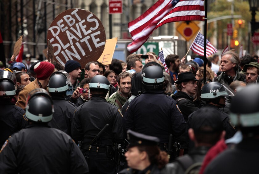 The wages of income inequality: Occupy Wall Street protesters clash with police in 2011.