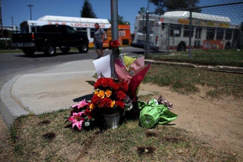 A makeshift memorial for David Sal Silva set up on an East Bakersfield street corner in 2013.