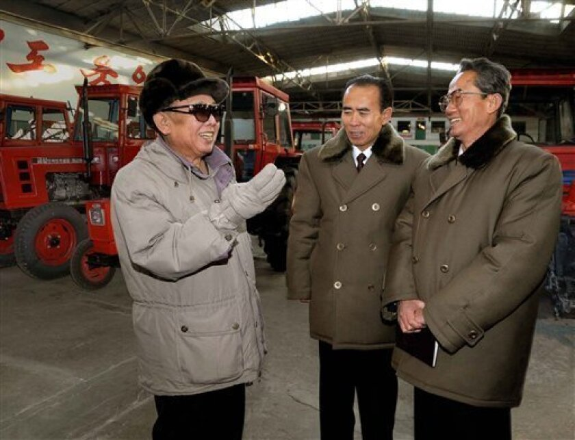 In this undated but recent photo released on Wednesday, Jan. 14, 2009 by Korean Central News Agency via Korea News Service, North Korean leader Kim Jong Il, left, visits the Kum Song Tractor Plant in Pyongannamdo, North Korea. Others are unidentified. (AP Photo/Korean Central News Agency via Korea