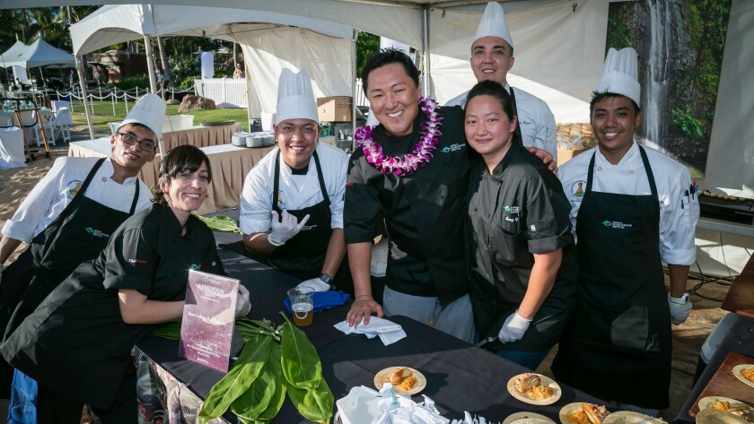 Surrounded by his culinary crew, L.A. chef Sang Yoon, center, will be cooking at the Hawaii Food & Wine Festival.