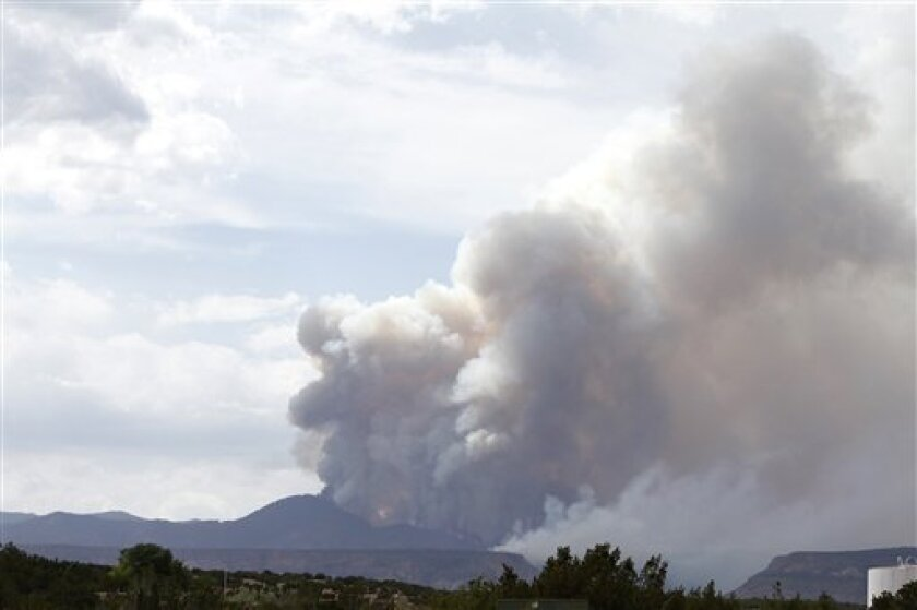 Smoke is seen on the drive towards Cochiti Pueblo on Thursday, June 30, 2011. A raging blaze that has become one of the largest forest fires in New Mexico history left the leader of one Native American community with a sinking feeling Thursday as it burned through cultural sites and threatened an i