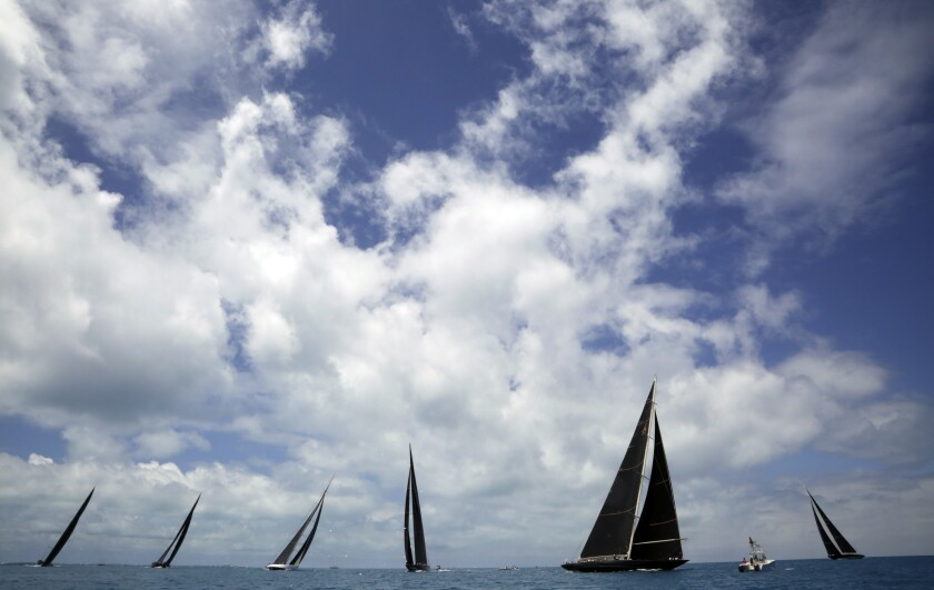 "FILE - In this June 19, 2017, file photo, J Class boats race as part of America's Cup sailing event, in waters off of Bermuda. Government agencies probing possible misuse of public funds in the staging of next year's America's Cup sailing regatta have also expressed concerns about Cup organizers' ability to host a ""safe and successful"" event. A June 22, 2020, letter to Team New Zealand and America's Cup Events from the heads of a government ministry and the Auckland City Council, obtained by New Zealand media, raises questions about the use of taxpayer funds allocated to assist in the staging of the 36th Cup defense in 2021. (AP Photo/Gregory Bull, File)"