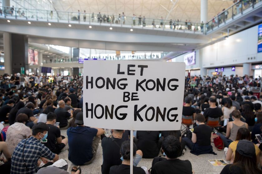 Anti-government protesters rally in Hong Kong airport, China - 09 Aug 2019