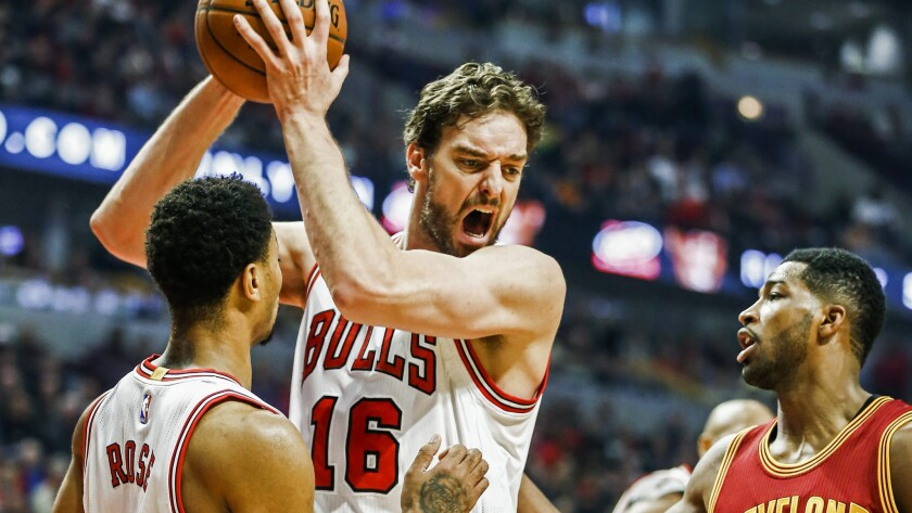 Chicago Bulls forward Pau Gasol, center, grabs a rebound in front of teammate Derrick Rose, left, and Cleveland Cavaliers forward Tristan Thompson during a game on Oct. 31.