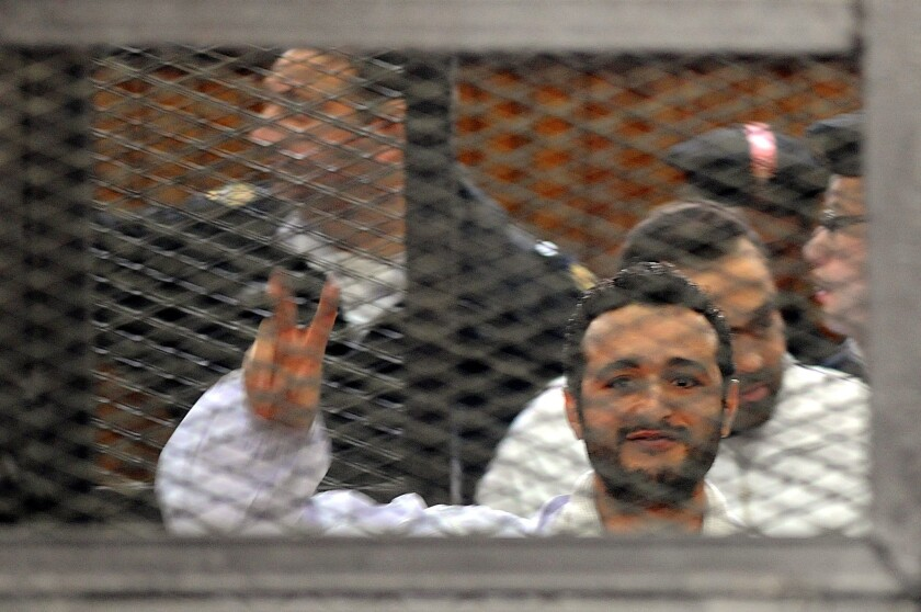 Egyptian court upholds prison terms for three activists
