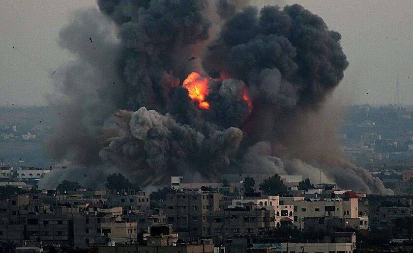 Smoke rises after an Israeli airstrike in the south of Gaza City on July 8.