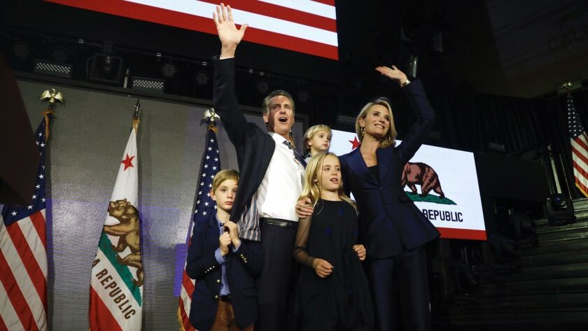 Gavin Newsom with wife Jennifer Siebel Newsom and family celebrating his win as Governor of Californ