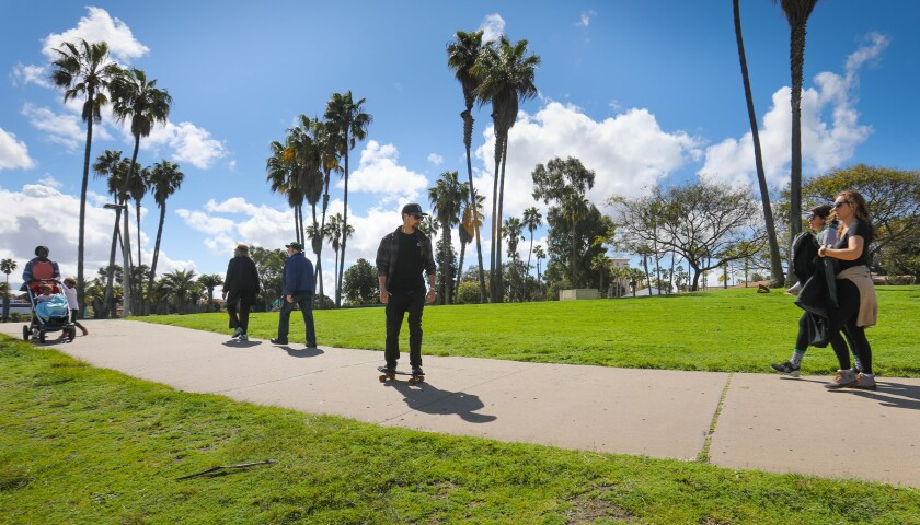 With schools and many businesses closed due to the coronavirus outbreak, many San Diegans headed to Mission Bay Park on March 17 to walk and ride along the path at Leisure Lagoon.