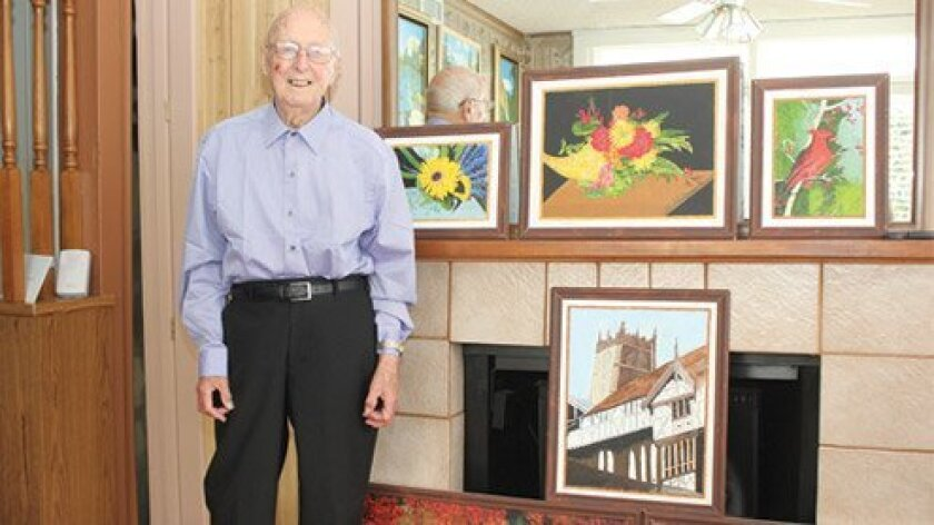 Alfred Scutt shows off some of his own paintings, including those depicting buildings and english nature scenes. Ashley Mackin
