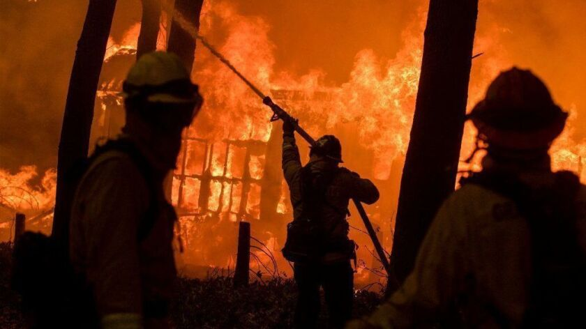 Firefighters battle the Camp fire in Butte County, Calif., on Nov. 9.