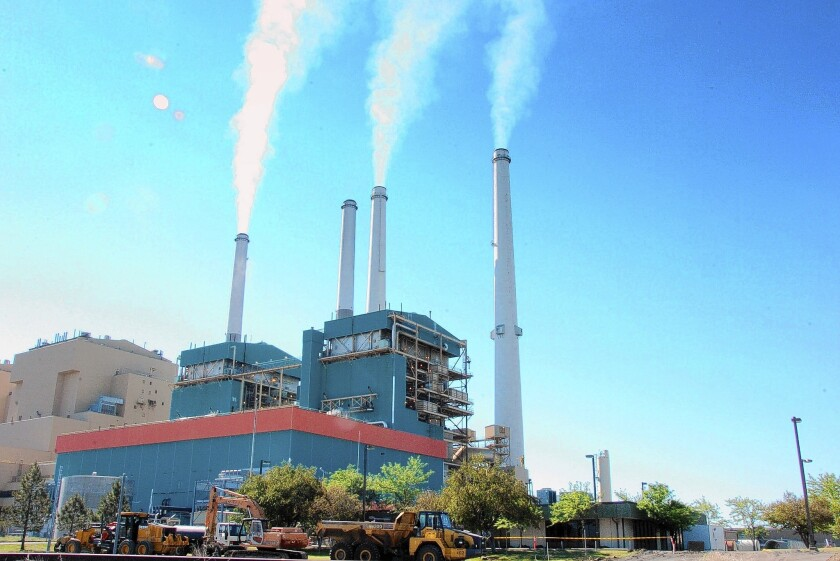 Some environmental watchdogs contend the administration's system of leasing federal lands for coal mining undercuts its efforts to reduce greenhouse gas emissions. Above, the Colstrip Steam Electric Station, a coal burning power plant in in Colstrip, Mont.
