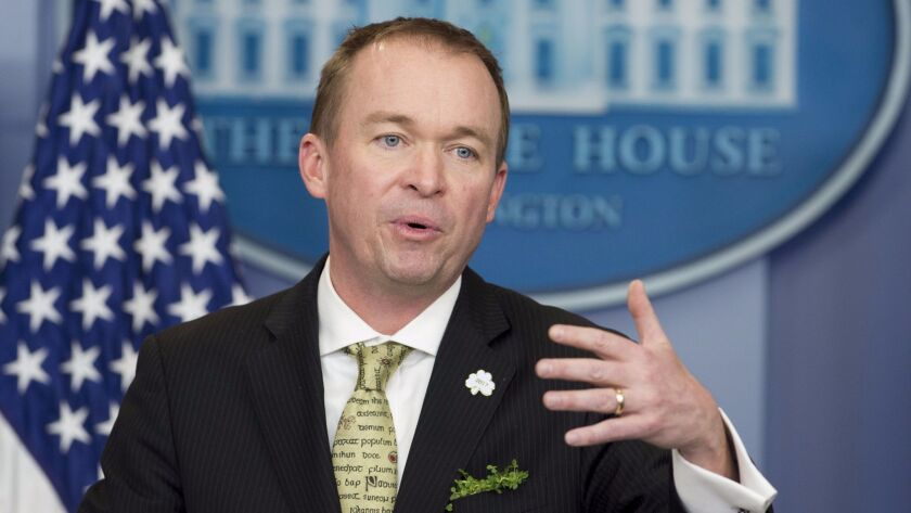 Office of Management and Budget Director Mick Mulvaney attends a March 16, 2017, news briefing in Washington.