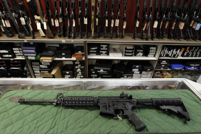 An AR-15 style rifle is displayed at the Firing-Line indoor range and gun shop in Aurora, Colo., in 2012.