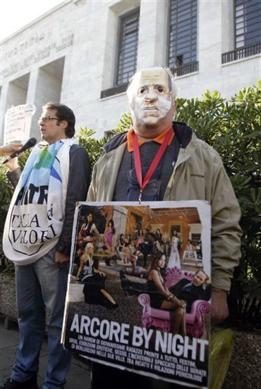 "A man wearing a mask of Italian Premier Silvio Berlusconi holds a placard reading ""Arcore by night"", a reference to Berlusconi's villa in the village of Arcore, near Milan, where he allegedly hosted parties, during a protest outside the Milan court, Italy, Wednesday, April 6, 2011. The trial of Premier Silvio Berlusconi on charges he paid for sex with an underage prostitute, then tried to use his influence to cover it up was adjourned shortly after it opened in Milan on Wednesday. Berlusconi did not attend the hearing, which lasted seven minutes and was devoted to formalities. The trial was adjourned to May 31. (AP Photo/Luca Bruno)"