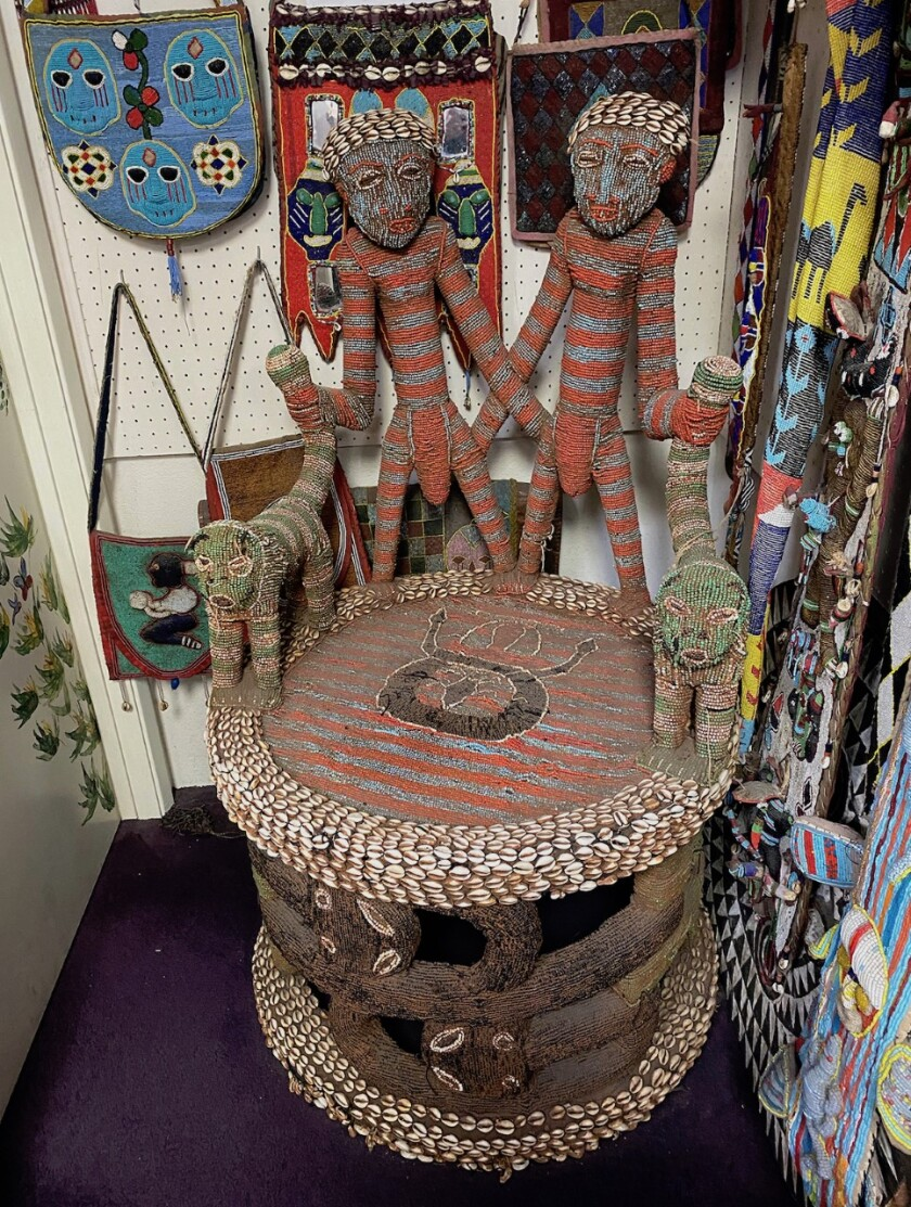 An African King's Chair, from the Yoruba tribe of Nigeria, now sitting outside the museum in the back of the store.