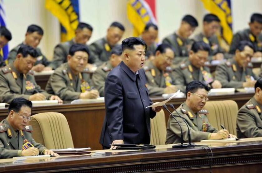 North Korean leader Kim Jong Un reportedly ordered the public executions of 80 people this month to send a message of intolerance of what the communist regime considers corruptive foreign influence. He is shown in this picture from a meeting last month with the country's military leaders.