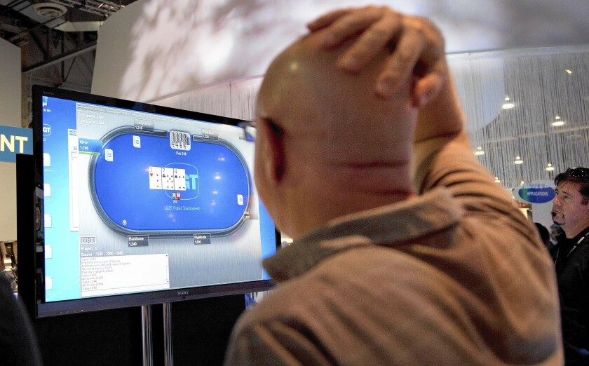 Casino industry representatives and exhibitors watch an online poker game at a 2011 gaming conference in Las Vegas. One of the most explosive issues dividing California's Indian tribes is whether PokerStars should be allowed to participate if the state legalizes online card play.