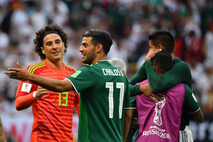 Mexico's goalkeeper Guillermo Ochoa (L) and Mexico's forward Carlos Vela celebrate their 1-0 victory at the end of the Russia 2018 World Cup Group F football match between Germany and Mexico at the Luzhniki Stadium in Moscow on June 17, 2018.
