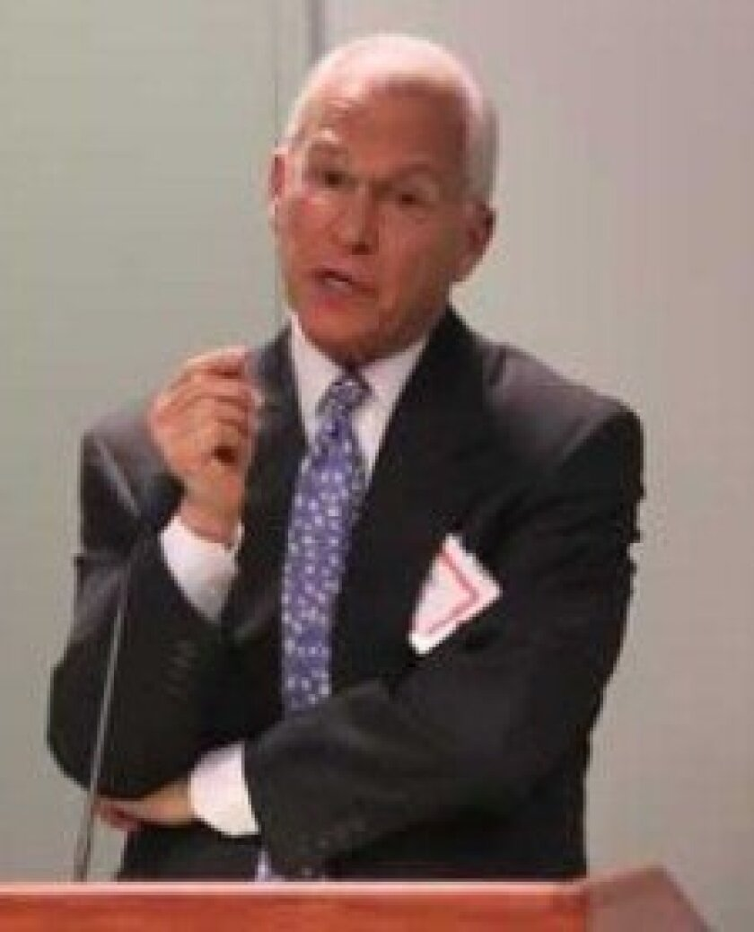 High-profile criminal defense attorney Roger J. Rosen addresses the April 4 meeting of the Group of 12 & Friends at Sanford-Burnham Medical Research Institute. Pat Sherman