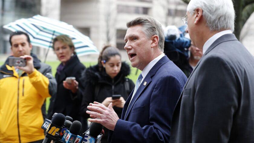 Mark Harris, center, Republican candidate for North Carolina's 9th Congressional District seat, spea