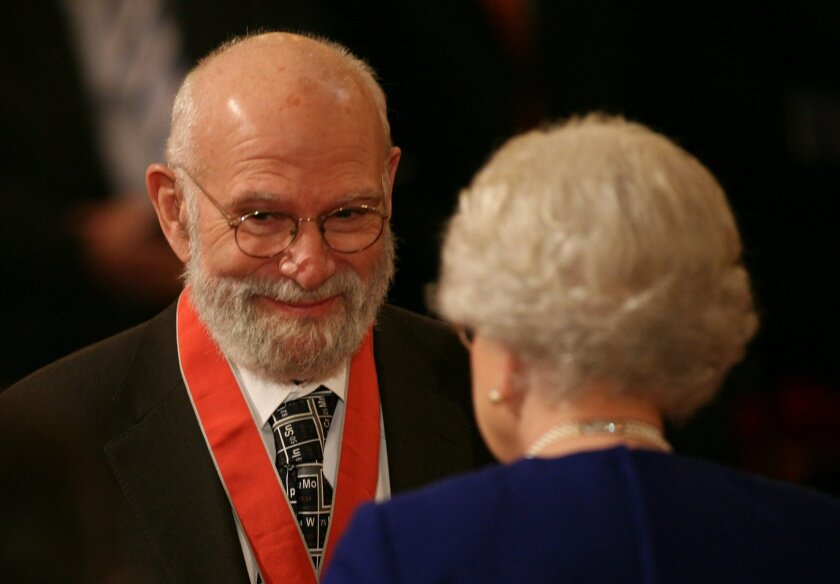 """FILE - This is a  Nov. 26, 2008 file photo of  Dr Oliver Sacks, receiving his Commander of the Order of the British Empire (CBE ), by  Britain's Queen Elizabeth II at Buckingham Palace, London. Dr. Oliver Sacks, whose books like """"The Man Who Mistook His Wife For a Hat"""" probed distant ranges of huma"""