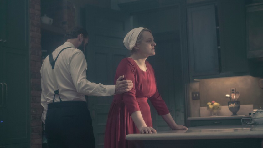 """Joseph Fiennes and Elisabeth Moss in a scene from the second season of """"The Handmaid's Tale,"""" which received 20 Emmy nominations Thursday."""