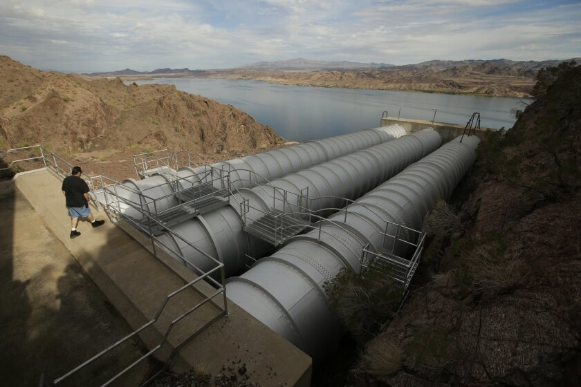 In this Thursday, Oct. 15, 2015 photo, mechanic John Harper walks onto the pipes conveying water pumped from the Colorado River at the Metropolitan Water District of Southern California's Whitsett Intake Pumping Plant near Parker Dam, Calif. The pumping plant is the starting point of the Colorado R