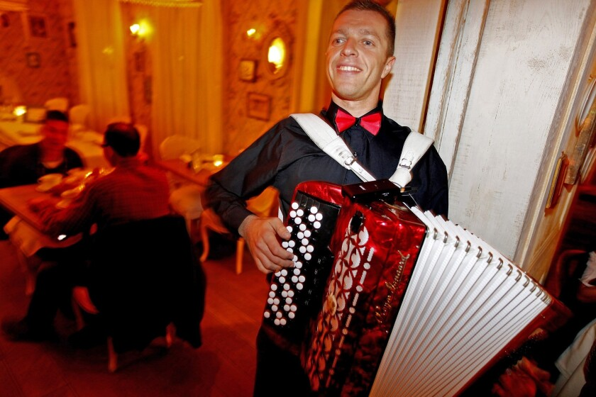 John Harmon plays the button accordion at Mari Vanna, a Russian-style restaurant on Melrose Place in Los Angeles.