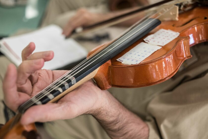 An inmate practices the violin during a music workshop at the Lee Correctional Institution in Bishopville, S.C., Tuesday, Feb. 9, 2016. After a weeklong workshop with the Decoda chamber ensemble, several dozen inmates will perform original music in a concert for the larger incarcerated community, s