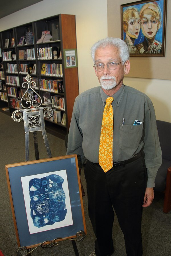 """Artist Greg Brown with his piece """"First Glance"""""""