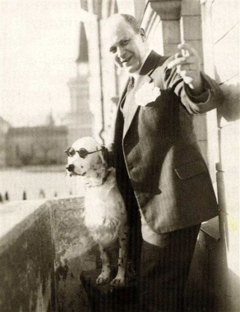 The undated photo taken from a book on the history of Finnish Tamro Group shows Tor Borg and his dog Jackie. The dog was dubbed Hitler by Borg's wife as it raised its paw for the Nazi salute. The Nazis started an investigation against the dog's owner, a 41-year-old wholesale merchant in Finland. In the middle of World War II, the Foreign Office in Berlin commanded its diplomats in the Nazi-friendly Nordic country to gather evidence against the Hitler-saluting hound and forged plans to destroy the dog owner's existence. (AP Photo/Tamro Group image bank)