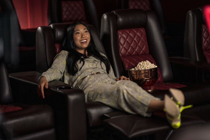A woman reclining in a luxurious cinema seat