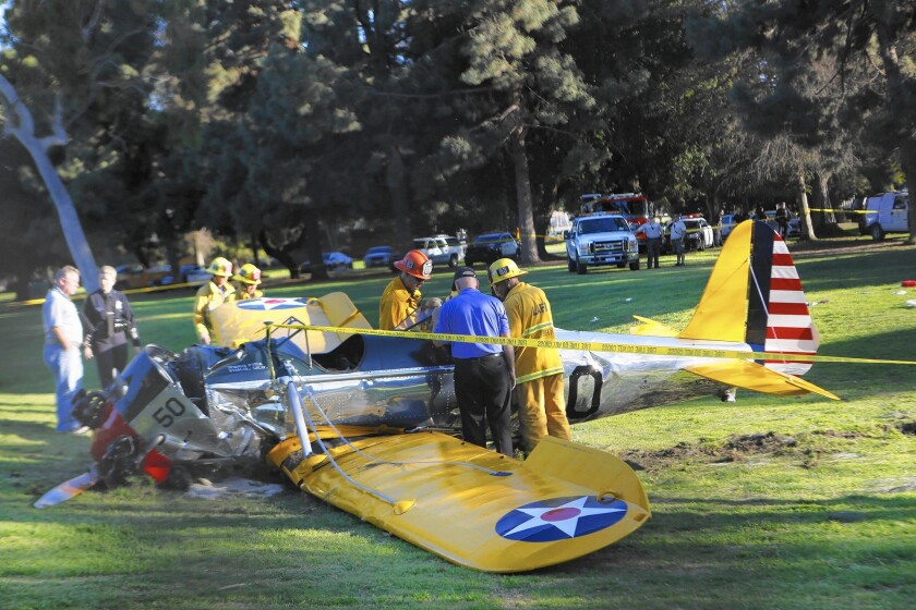A vintage single-engine airplane piloted by actor Harrison Ford sits on the Penmar golf course in Venice after crashing.