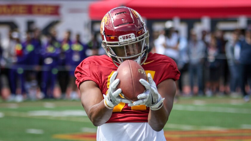 USC receiver John Jackson III looks a pass in during a drill at the Trojans' spring showcase on Apr
