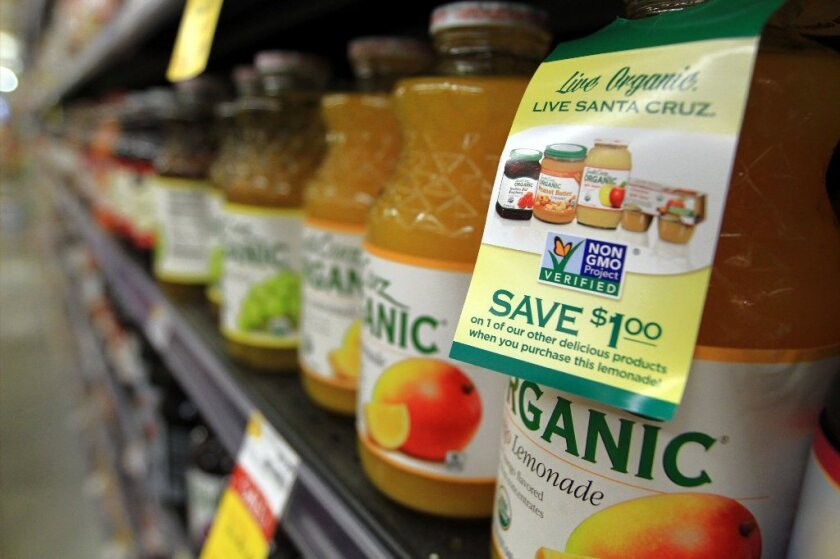 Whole Foods is the first supermarket chain to require its suppliers to put GMO labels on their products. A bill in California would require the labeling of bioengineered food.