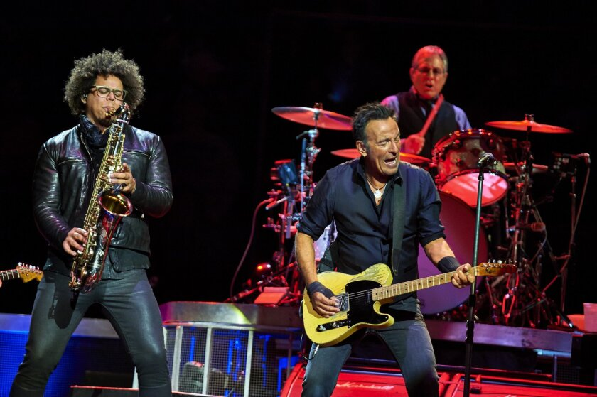 Bruce Springsteen, center, Max Weinberg, and Jake Clemons, left, perform with the E Street Band at Madison Square Garden, Wednesday, Jan. 27, 2016, in New York.  (Photo by Robert Altman /Invision/AP)